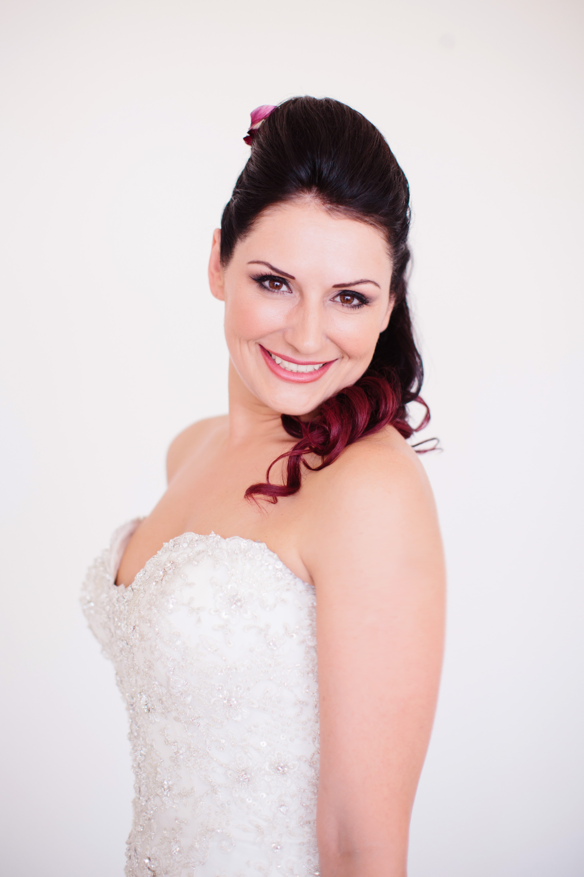 Gold Coast bridal hair and makeup – feathers and raspberry hair colour